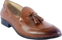 URBAN NATION Single Piece Leather Slip On With Metal Tassels Slip On Tan